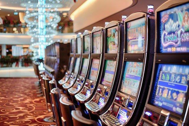 A line of slot machines in a casino