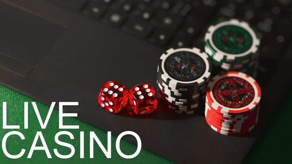 Casino chips and dice on a laptop